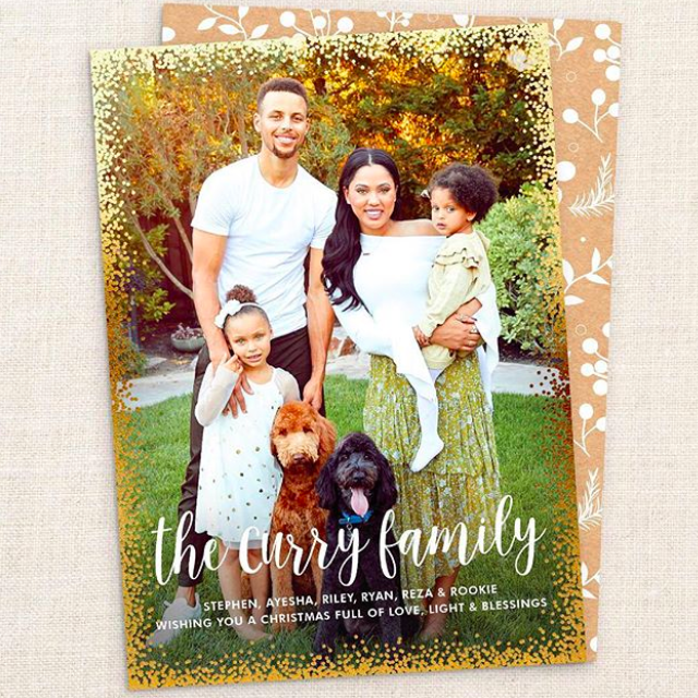"""What a photogenic crew! Ayesha, who was also paid, was so happy the way her card with her baller hubby Stephen Curry and their kids turned out. """"Even the dog smiled,"""" she noted. The kids, Riley and Ryan, are precious. (Photo: <a href=""""https://www.instagram.com/p/BbzzOb4A3tJ/?taken-by=ayeshacurry"""" rel=""""nofollow noopener"""" target=""""_blank"""" data-ylk=""""slk:Ayesha Curry via Instagram"""" class=""""link rapid-noclick-resp"""">Ayesha Curry via Instagram</a>)"""