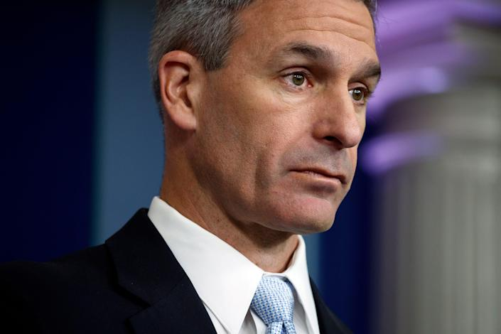 Acting Director of United States Citizenship and Immigration Services Ken Cuccinelli, listens to a question during a briefing at the White House, Monday, Aug. 12, 2019, in Washington. (AP Photo/Evan Vucci)