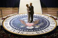 <p>President and First Lady Bush attend the inaugural ball on the night of his second Presidential inauguration in 2005. To celebrate, they shared a dance on the Presidential seal at their event. </p>