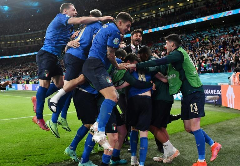 Italy players celebrate after beating Spain on penalties in their Euro 2020 semi-final at Wembley