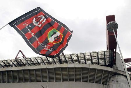 AC Milan's flag waves in front of San Siro stadium in Milan