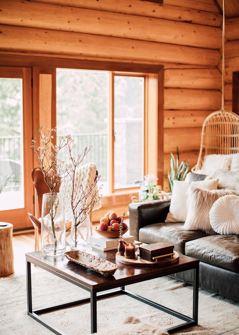 Built in 1995, the new-age log cabin, comprised predominantly of large wooden logs, is complete with soaring vaulted ceilings. Furnished with earthy, mountain-inspired textures and tones, each room exudes warmth and coziness.