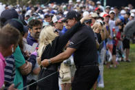 Phil Mickelson hugs his wife, Amy Mickelson, on the seventh fairway during the second round of the U.S. Open Golf Championship, Friday, June 18, 2021, at Torrey Pines Golf Course in San Diego. (AP Photo/Marcio Jose Sanchez)