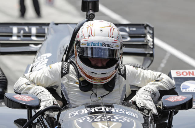 Jordan King, of England, climbs out of his car following a practice session for the IndyCar Grand Prix auto race at Indianapolis Motor Speedway, in Indianapolis Friday, May 11, 2018. (AP Photo/Darron Cummings)