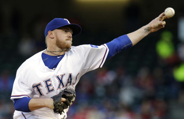 Texas Rangers starting pitcher Robbie Ross Jr. throws during the first inning of the MLB American baseball game against the Seattle Mariners Tuesday, April 15, 2014, in Arlington, Texas. (AP Photo/LM Otero)