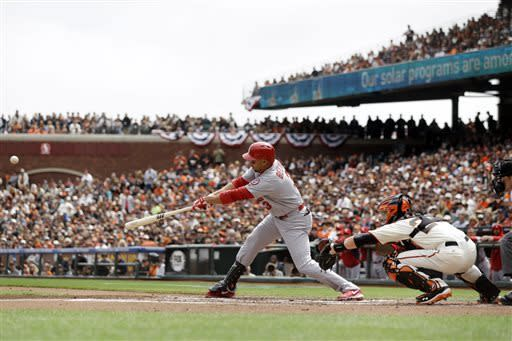 St. Louis Cardinals' Carlos Beltran drives in a run with a single against the San Francisco Giants during the first inning of a baseball game on Saturday, April 6, 2013, in San Francisco. (AP Photo/Marcio Jose Sanchez)