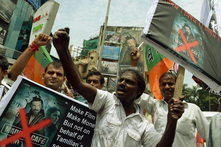 "Indian Tamils protest against the release of ""Madras Cafe"" in Mumbai on August 22, 2013. The Bollywood spy thriller set against the backdrop of the Sri Lankan civil war has been pulled from British and some Indian theatres after protests over its depiction of rebel fighters"