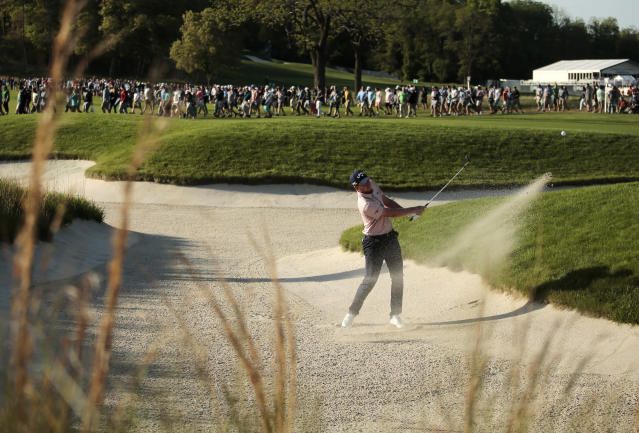 Daniel Berger hits out of a bunker on the 16th hole during the third round of the PGA Championship golf tournament, Saturday, May 18, 2019, at Bethpage Black in Farmingdale, N.Y. (AP Photo/Andres Kudacki)