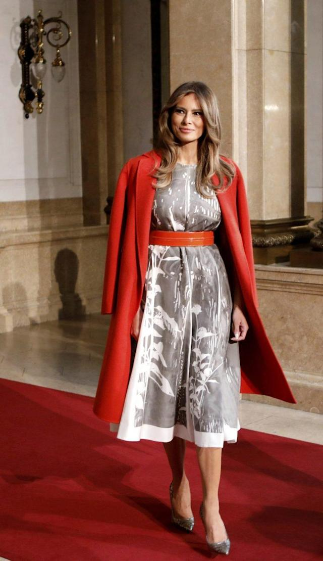 Melania Trump sporting a cape-style look, harking back to classic European styling. (Photo: AP)