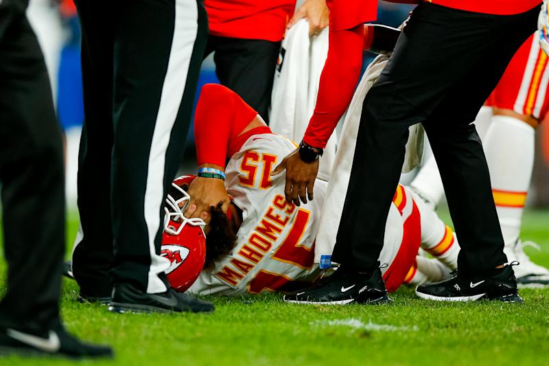 Quarterback Patrick Mahomes of the Kansas City Chiefs reacts after getting injured on a play during the second quarter against the Denver Broncos. (Getty Images)