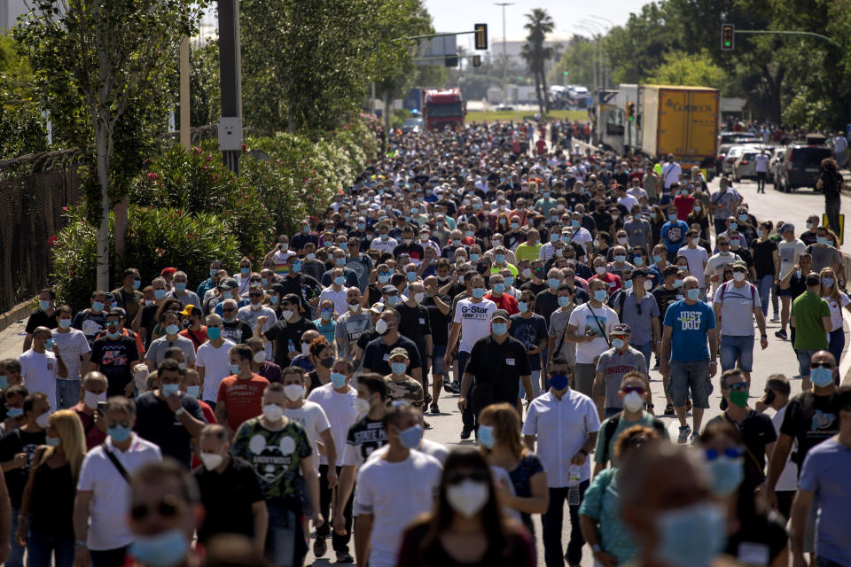 Nissan workers march during a protest in Barcelona, Spain, Thursday, May 28, 2020. Japanese carmaker Nissan Motor Co. has decided to close its manufacturing plans in the northeastern Catalonia region, resulting in the loss of some 3,000 direct jobs. (AP Photo/Emilio Morenatti)
