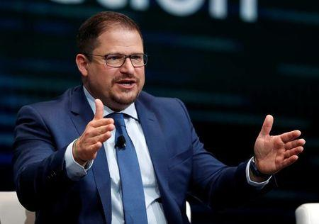 FILE PHOTO: Cristiano Amon, president of Qualcomm and Qualcomm CDMA Technologies, responds to a question during a panel discussion on 5G wireless broadband technology during the 2018 CES in Las Vegas, Nevada, U.S. January 10, 2018. REUTERS/Steve Marcus