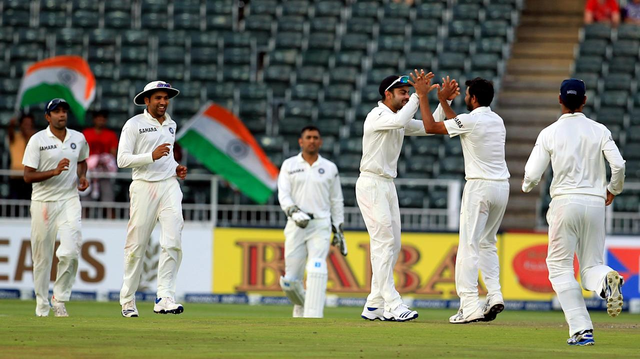 Indian players celebrate fall of a wicket on the 4th day of 1st Test match between India and South Africa at Wanderers in Johannesburg on Dec. 21, 2013. (Photo: IANS)
