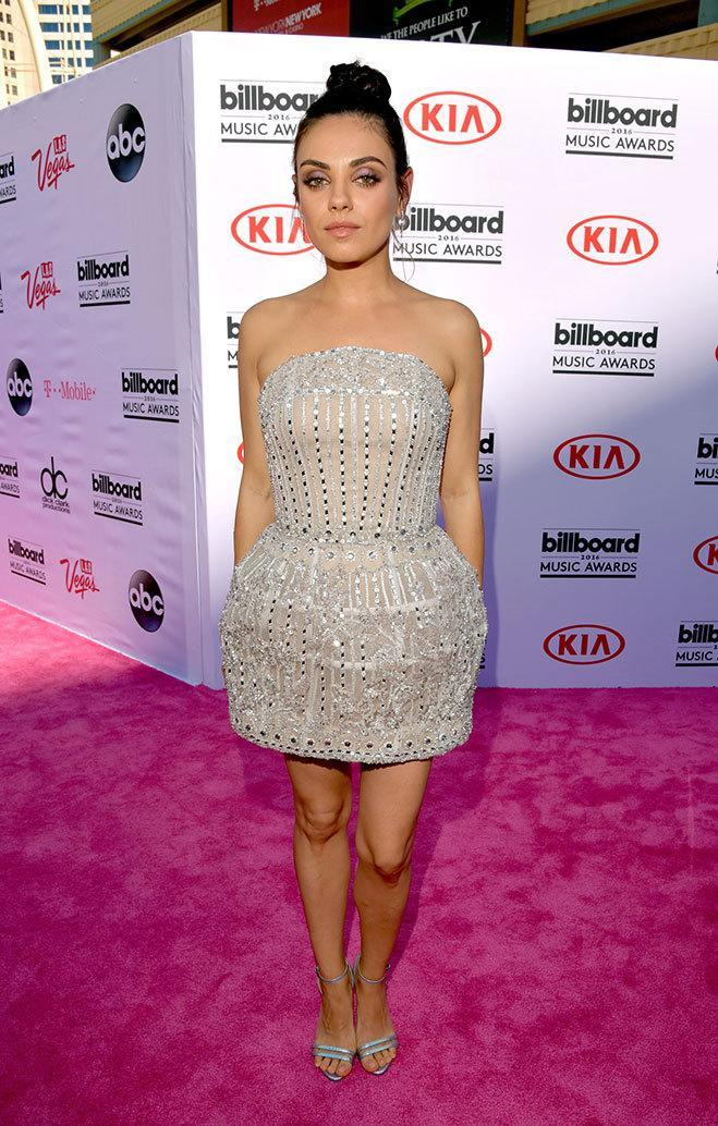 <p>Presenter Kunis arrived to promote her forthcoming film <i>Bad Moms</i> in an embellished minidress, highlighting her toned arms. <i>(Photo: Getty Images)</i></p>