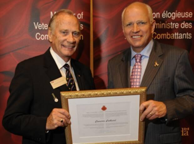 Cam Cathcart, left, receives a special Minister of Veterans Affairs Commendation in 2019.