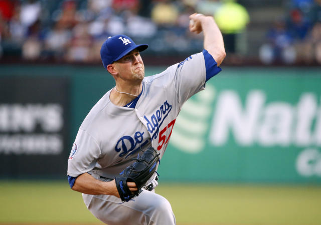 Los Angeles Dodgers starting pitcher Alex Wood (57) pitches against the Texas Rangers during the first inning of a baseball game Wednesday, Aug. 29, 2018, in Arlington, Texas. (AP Photo/Michael Ainsworth)