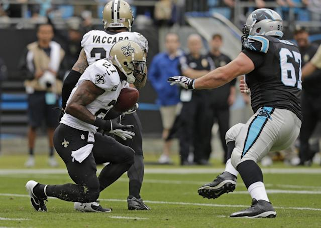 New Orleans Saints' Malcolm Jenkins (27) returns an interception as Carolina Panthers' Ryan Kalil (67) tries to make the tackle in the first half of an NFL football game in Charlotte, N.C., Sunday, Dec. 22, 2013. (AP Photo/Chuck Burton)