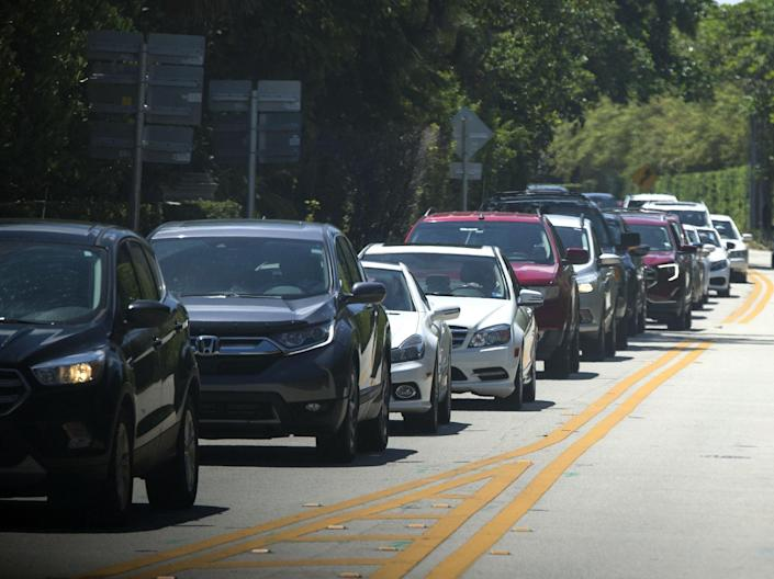 Traffic backs up on South Ocean Boulevard as President Donald Trump's motorcade returns to Mar-a-Lago during a recent visit. {BRUCE R. BENNETT/palmbeachpost.com}