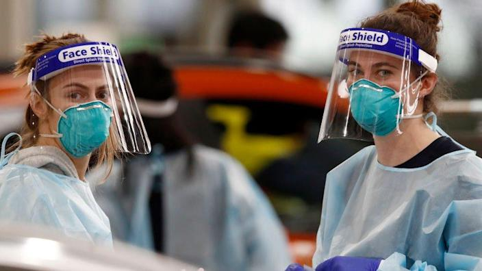 Medical staff perform COVID-19 testing at a drive through testing site in South Melbourne on May 26, 2021 in Melbourne, Australia.