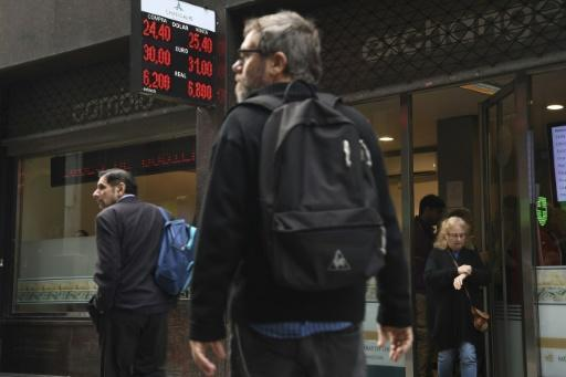 The Argentine peso, on display in a buy-sell board in Buenos Aires, has lost 20 percent of its value over a six-week period