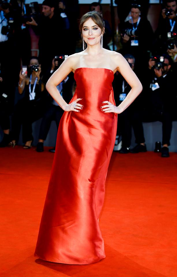 <p>Dakota turned to Dior for her shimmering, strapless red dress.<em> [Photo: Getty]</em> </p>