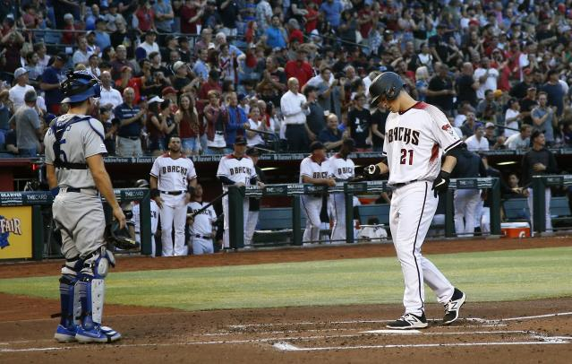 Arizona Diamondbacks' Zack Greinke (21) arrives at home plate after hitting a home run as Los Angeles Dodgers catcher Austin Barnes, left, pauses nearby during the second inning of a baseball game Monday, June 24, 2019, in Phoenix. (AP Photo/Ross D. Franklin)