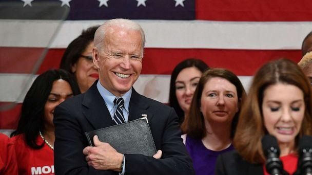 PHOTO: Democratic presidential candidate Joe Biden looks on as Shannon Watts, Founder of Moms Demand Action speaks during a campaign stop at Driving Park Community Center in Columbus, Ohio, March 10, 2020. (Mandel Ngan/AFP/Getty Images)