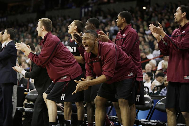 Harvard's bench celebrates in the second half during the third-round game of the NCAA men's college basketball tournament against Michigan State, in Spokane, Wash., Saturday, March 22, 2014. (AP Photo/Young Kwak)