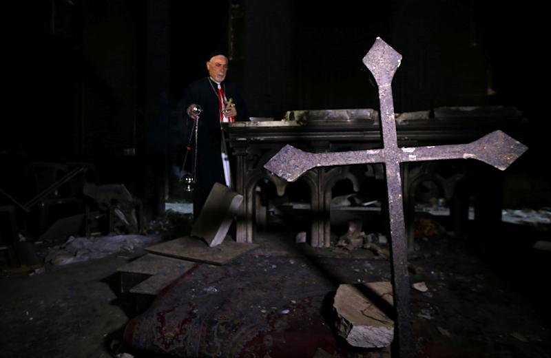 Archbishop Yohanna Petros Mouche of Mosul prays at the St. George Syriac Catholic Church in the Christian Iraqi town of Bartella, east of Mosul on October 30, 2016