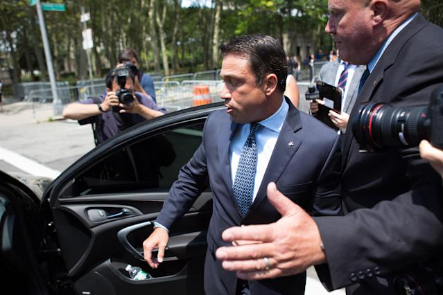 Former U.S. Rep. Michael Grimm, center, leaves following his sentencing in federal court on July 17, 2015, in Brooklyn, N.Y. He was sentenced to eight months in prison for tax evasion. (Photo: Kevin Hagen/AP)