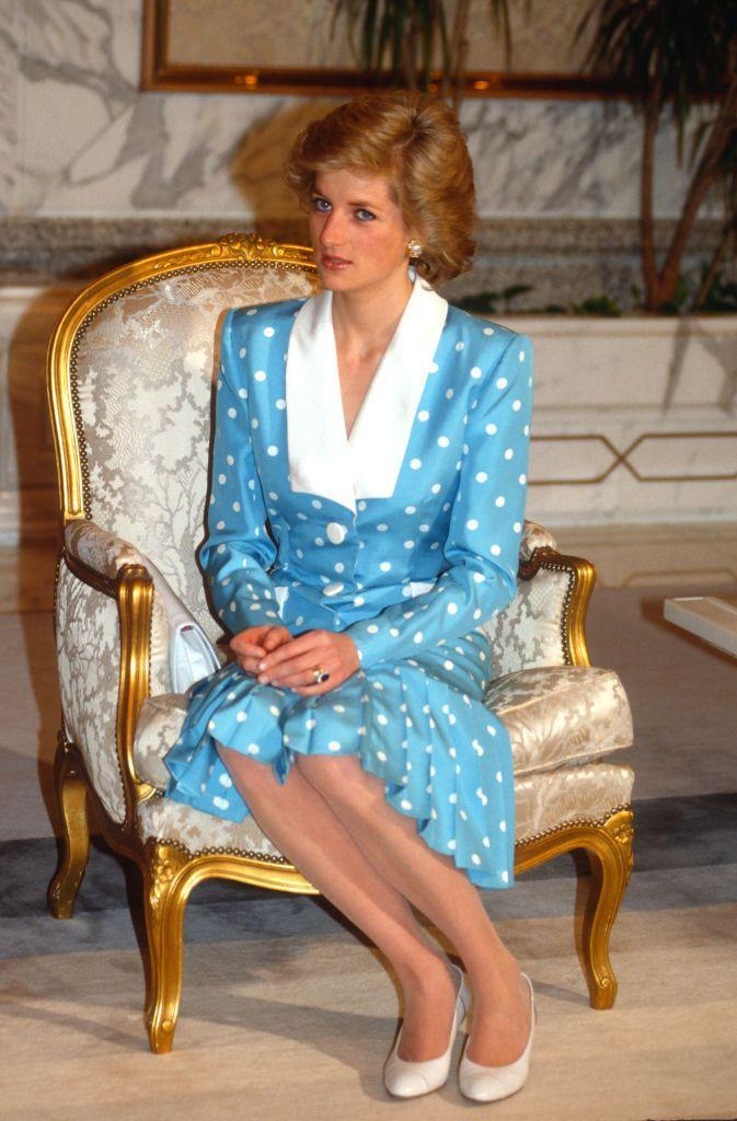 """<p>A <a href=""""https://www.townandcountrymag.com/society/tradition/g31818265/queen-elizabeth-princess-diana-kate-middleton-royal-polka-dots-fashion-photos/"""" rel=""""nofollow noopener"""" target=""""_blank"""" data-ylk=""""slk:lover of polka dots"""" class=""""link rapid-noclick-resp"""">lover of polka dots</a>, Diana chose a blue and white Catherine Walker dress with a white collar to an event at Bayan Palace on March 13, 1989 in Kuwait.</p>"""
