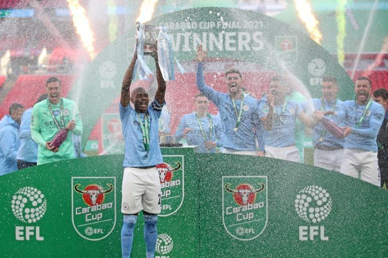 Four-midable: Manchester City won the League Cup for the fourth consecutive season with a 1-0 win over Tottenham