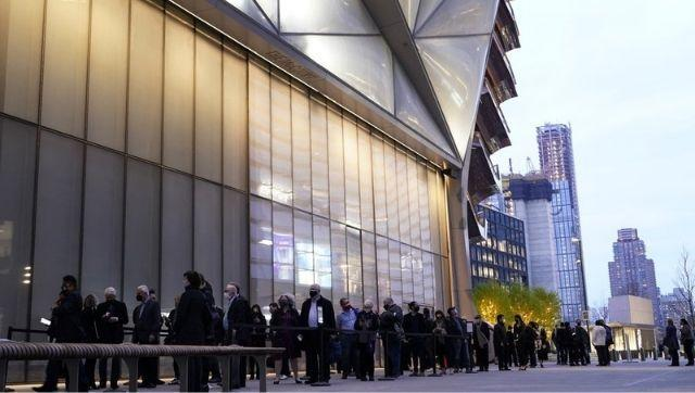 People line up outside The Shed before a live performance by the New York Philharmonic, whose members performed together for the first time since March 2020, on Wednesday, 14 April, 2021, at Hudson Yards in New York. Normal subscription performances are to resume in September. Photo via The Associated Press/Kathy Willens