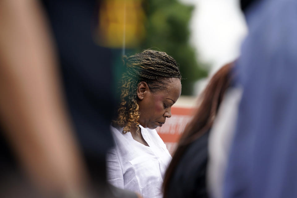 A person prays during a voting rights rally at Liberty Plaza near the Georgia State Capitol on Tuesday, June 8, 2021, in Atlanta. (AP Photo/Brynn Anderson)