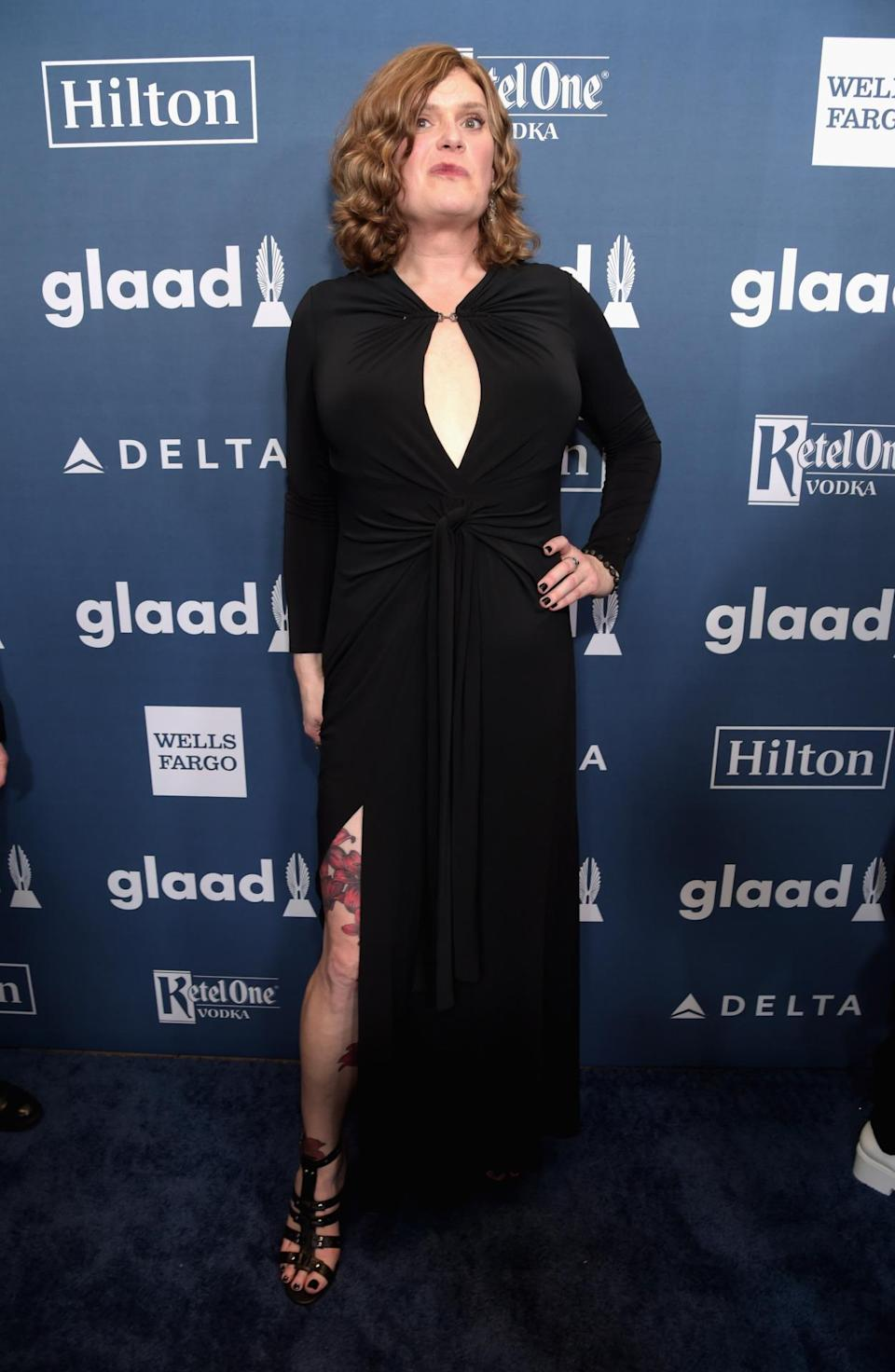 <p>Lilly Wachowski made her first public appearance since announcing her transition to female. For her red carpet debut, the director chose a black keyhole dress with a thigh-high slit that showed off tattoos. <i>(Photo: AP)</i></p>