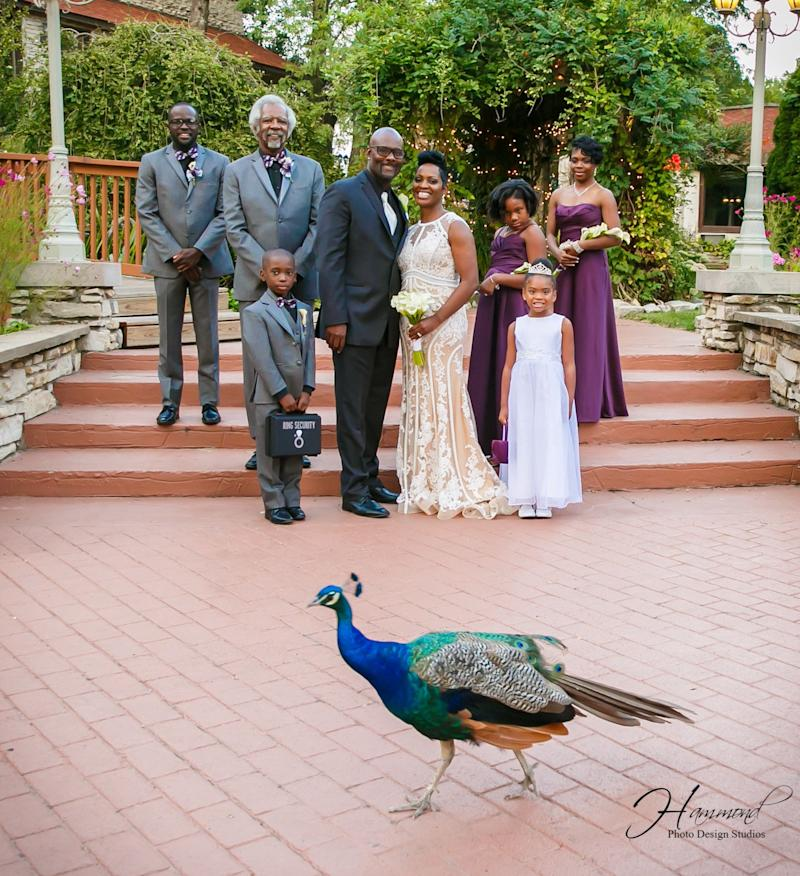 The wedding party included (from left to right): Denzel Goins (the bride's son), Albert Conway (the groom's father and best man), Joshua Stoxstell (the bride's nephew and ring bearer), Emile and Tamatha Conway (the newlyweds), Kaitlyn Conway (the groom's daughter and junior bridesmaid), Akira Jarmon (the bride's niece and flower girl), and Tracey Jarmon (the bride's sister and maid of honor.)