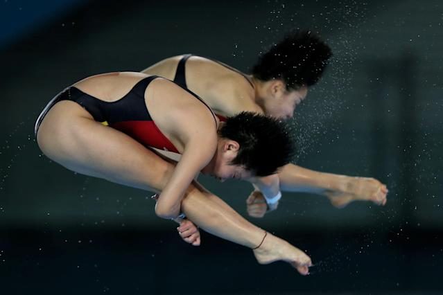 The tape must be waterproof if diver Hao Wang is wearing it. Look closely, it's on her back. (Photo: Clive Rose/Getty Images)