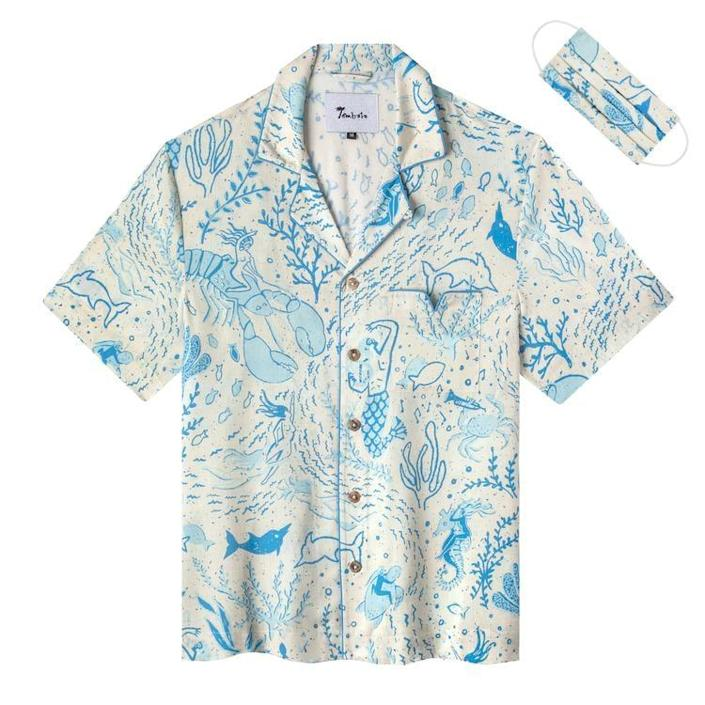 <p>For any Ariel-lovers honeymooning somewhere by the ocean, the <span>Tombolo Company Mar di Gras Eggshell Shirt</span> ($128) even comes with a matching mask for traveling.</p>