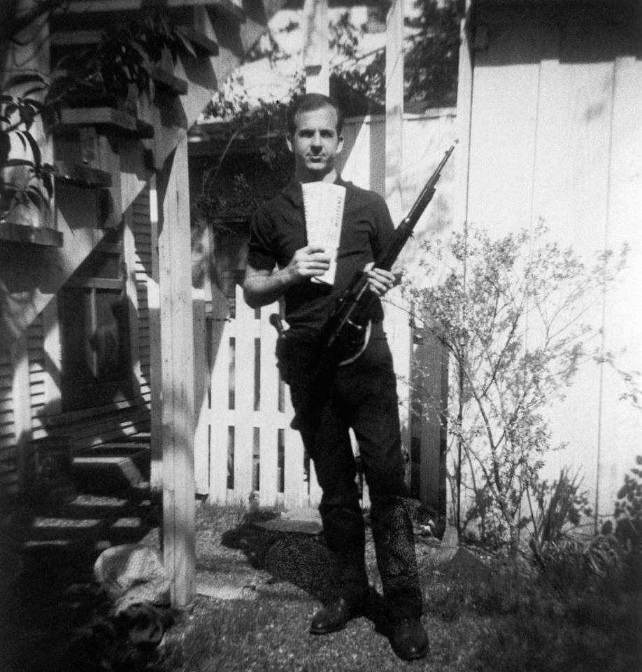<p>Lee Harvey Oswald holds a Mannlicher-Carcano rifle and newspapers in a backyard. This photograph is one of the controversial backyard photos used in the assassination of John F. Kennedy investigation in 1963. (Photo: Corbis via Getty Images) </p>
