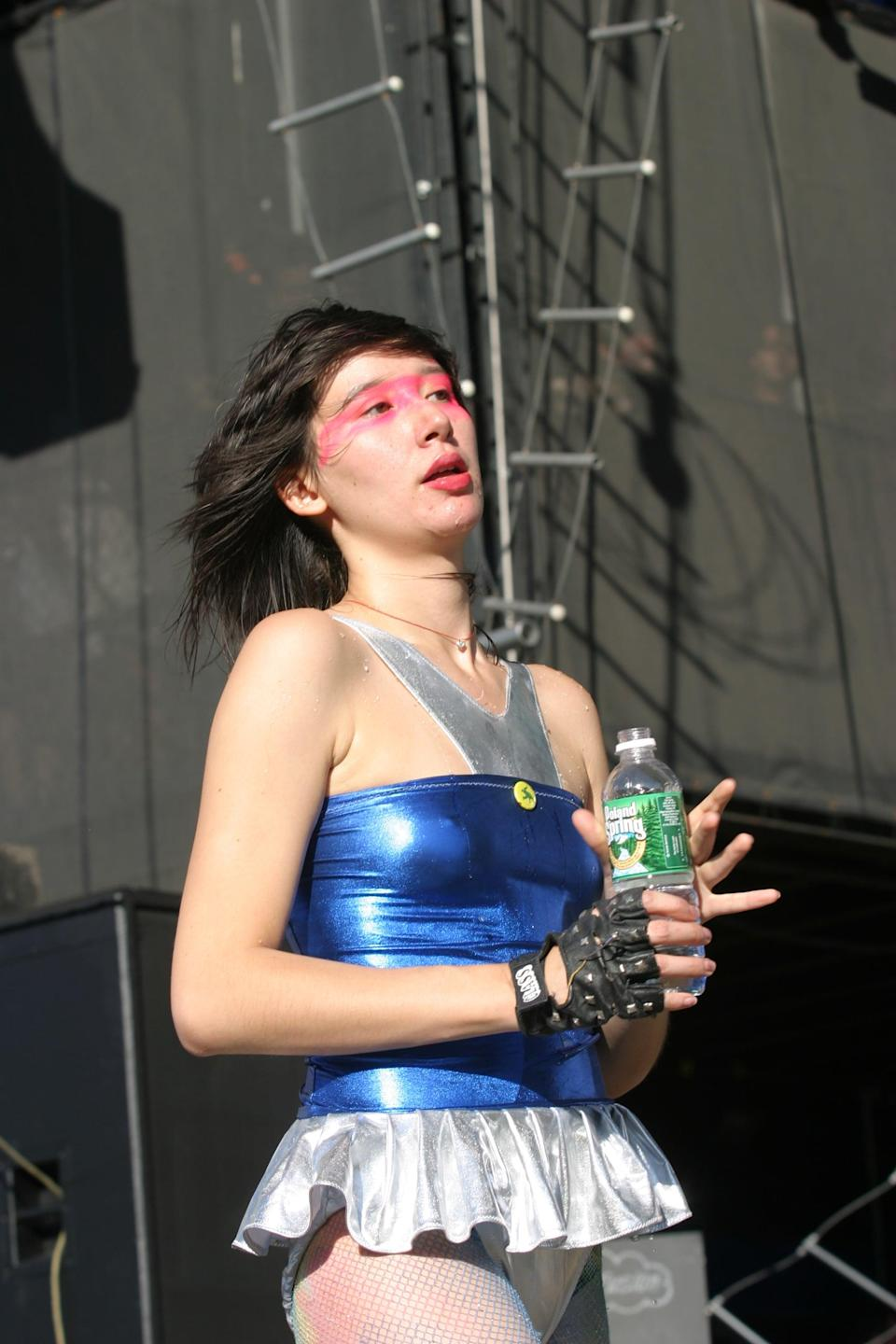 <p>In 2004 wearing a silver and blue ruffled bodysuit.</p>