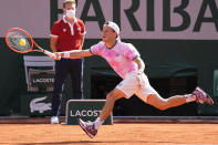 Argentina's Diego Schwartzman stretches to return the ball to Spain's Rafael Nadal during their quarterfinal match of the French Open tennis tournament at the Roland Garros stadium Wednesday, June 9, 2021 in Paris. (AP Photo/Michel Euler)