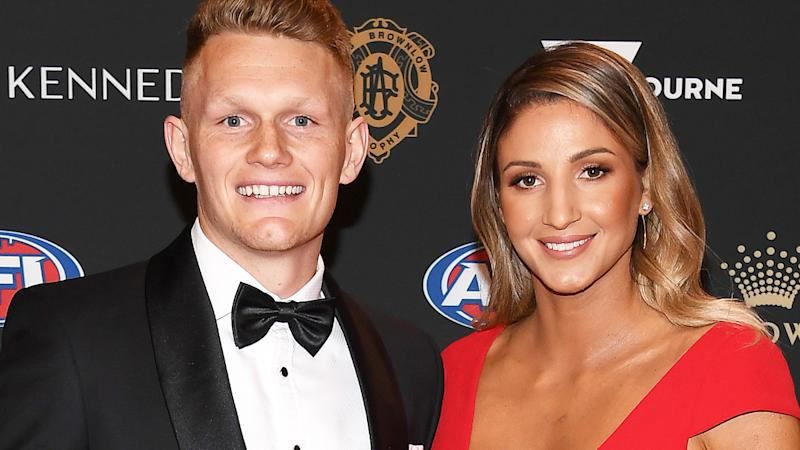 Adam Treloar and Kim Ravaillion, pictured here at the 2019 Brownlow Medal night.