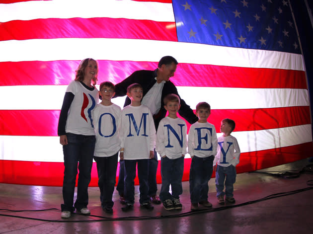 Republican presidential candidate, former Massachusetts Gov. Mitt Romney, poses for a photo with the Fisher family backstage prior to a campaign rally in Elko, Nev., Friday, Feb. 3, 2012. Campaigning throughout Nevada on Friday, Romney sought to convince weary voters that he alone had the prescriptions for what ails the country, even as the government reported that a quarter-million Americans streamed back into the work force in January. (AP Photo/Gerald Herbert)