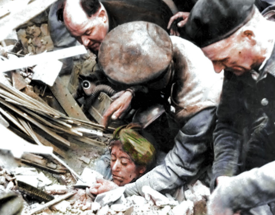 <p>A woman is rescued from the rubble after a V2 attack in Manor Park, East London. (MediaDrumWorld) </p>