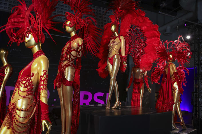 """Dancer costumes from the Norwegian Cruise Line production of """"Paradis"""" are displayed at the """"Showstoppers! Spectacular Costumes from Stage & Screen"""" exhibit, benefitting the Costume Industry Coalition Recovery Fund, in Times Square on Monday, Aug. 2, 2021, in New York. (Photo by Andy Kropa/Invision/AP)"""