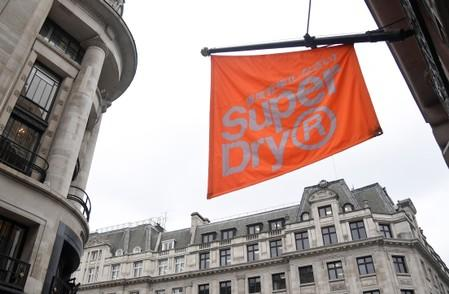 FILE PHOTO: Signage is seen at a Superdry store in London