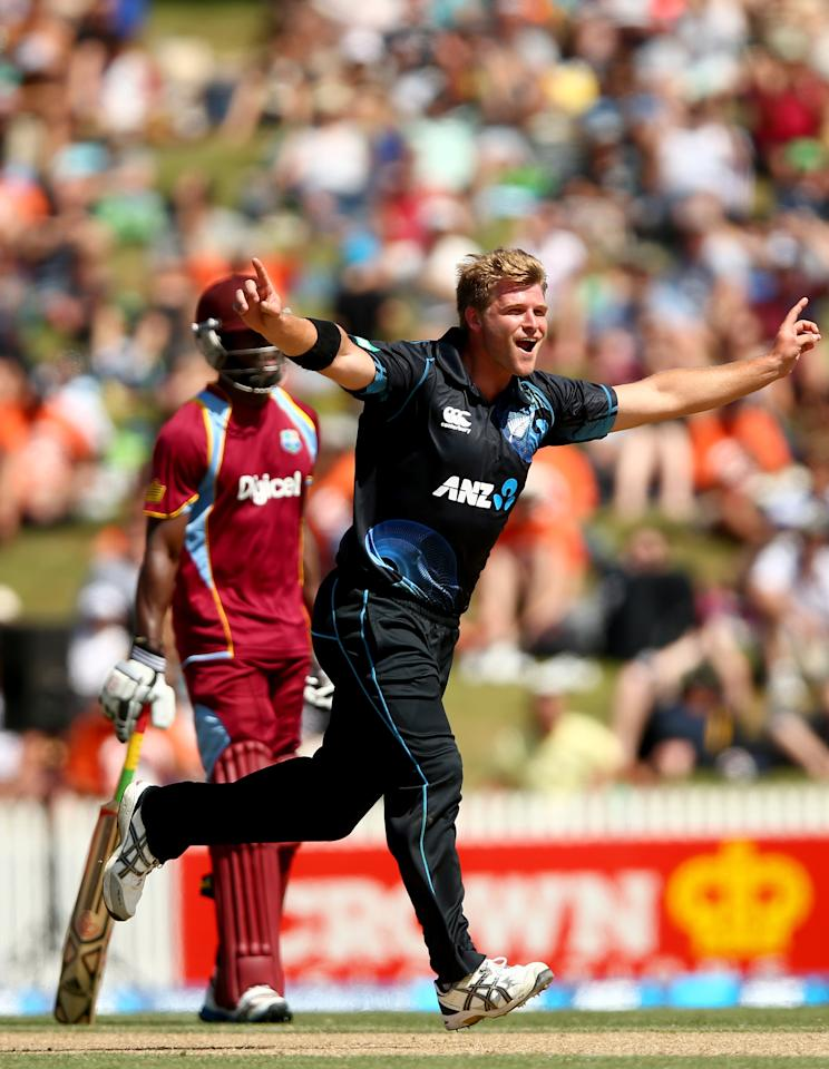 HAMILTON, NEW ZEALAND - JANUARY 08:  Corey Anderson of the Blackcaps celebrates his wicket of Lendl Simmons of the West Indies during game five of the One Day International Series between New Zealand and the West Indies at Seddon Park on January 8, 2014 in Hamilton, New Zealand.  (Photo by Phil Walter/Getty Images)