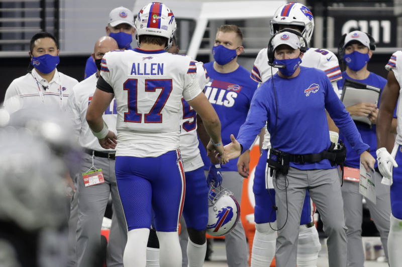 Buffalo Bills head coach Sean McDermott shakes hands with quarterback Josh Allen (17) after Allen scored a touchdown against the Las Vegas Raiders during the second half of an NFL football game, Sunday, Oct. 4, 2020, in Las Vegas. (AP Photo/Isaac Brekken)