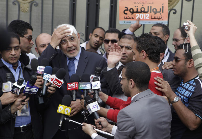 In this March 29, 2012 photo, presidential hopeful Abdel-Moneim Abolfotoh, a former Muslim Brotherhood leader who was expelled from the movement after he announced his decision to join the Presidential race, talks to reporters in front of the Higher Presidential Elections Commission in Cairo, Egypt. The presidential election scheduled in May will mark the beginning of a handover of power by the ruling military to an elected civilian, following last year's popular uprising that overthrew Hosni Mubarak. (AP Photo/Amr Nabil)