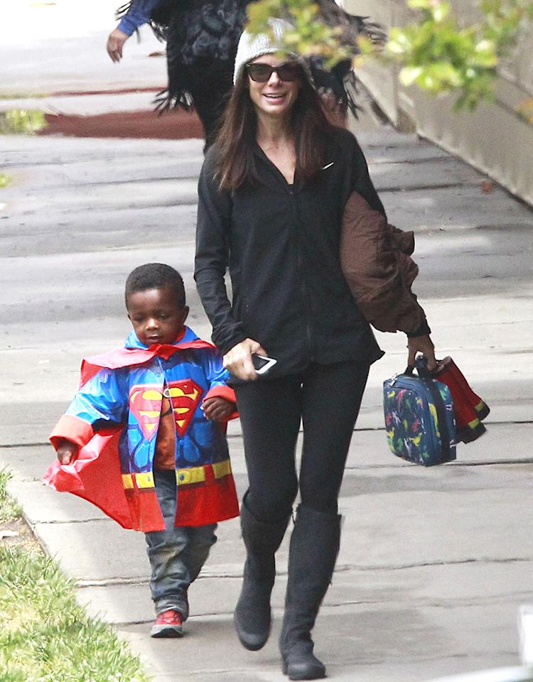 Sandra Bullock's little man Louis can easily transform himself into a superhero on a daily basis now that he's got that cool Superman cape jacket. The 3-year-old cutie was spotted walking home from school with his famous mom on Monday. (5/6/2013)